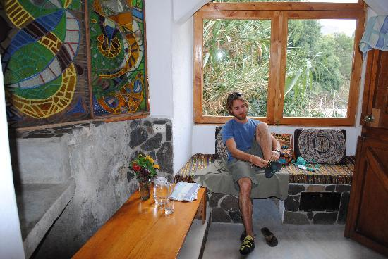 Lush Atitlan/Hotel Aaculaax: Chris getting ready to do a little bouldering in our Stone walled bathroom!