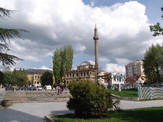 Pristina, Kosovo: from left to right: National Museum of Kosovo, City Mosque, the apartment building