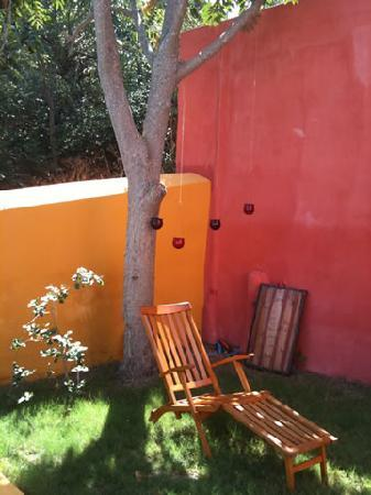 Boutique Hotel La Maison des Couleurs: The chair is waiting for somebody to relax on it!