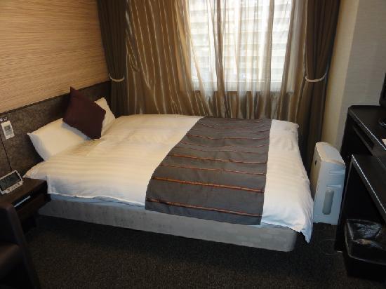 Dormy Inn Premium Kyoto Ekimae: チャコールグレイで落ち着いた色合いにまとめたセンスも○