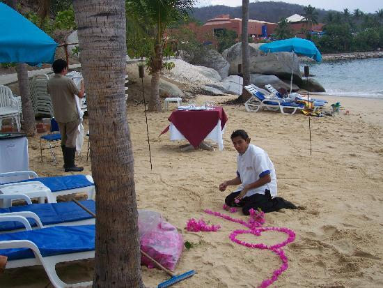 Las Brisas Huatulco: Staff Setting Up for Romantic Dinner on the Beach$$