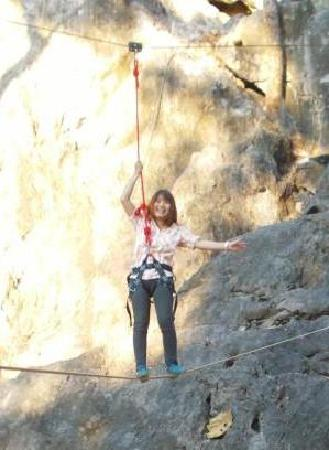 Boomerang Rock Climbing and Adventure Park: slackline first timer - note; she's tethered to overhead safety cable