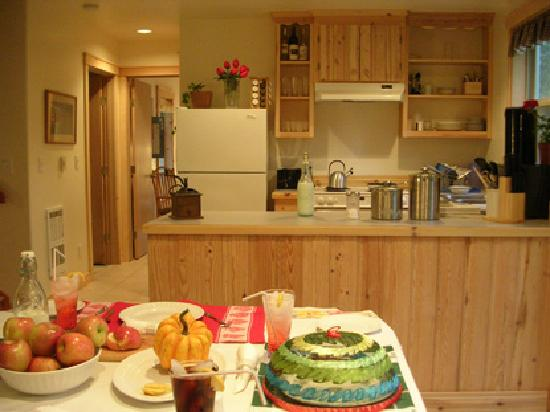 Laughing Moon Farm: New, hand-crafted cottages have wood interiors, fireplaces, full kitchens, covered patios, TV-DV