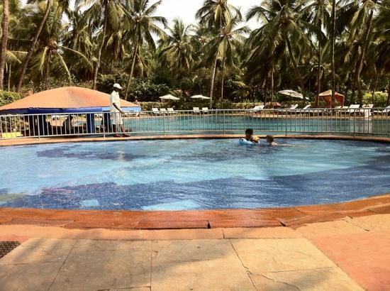Vivanta by Taj - Holiday Village, Goa: kids pool and the pool bar at the background.