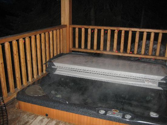 Private hot tub on private deck at private cabin