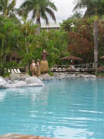 Outrigger Fiji Beach Resort: Lighting the pool side torches every night.