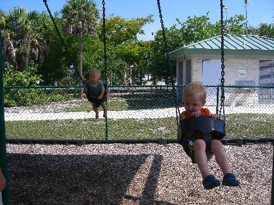 ‪‪Sanibel Arms Condominiums‬: Swinging at the Playground - Sanibel‬