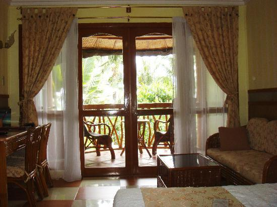 Red Coconut Beach Hotel: Each beach-front room has a veranda overlooking the pool and the beach beyond