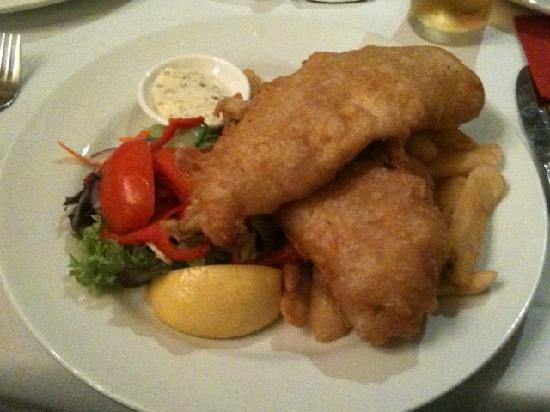 Sussex Hotel: Pub style fish in beer batter with chips and salad- good value at AUD 17.90
