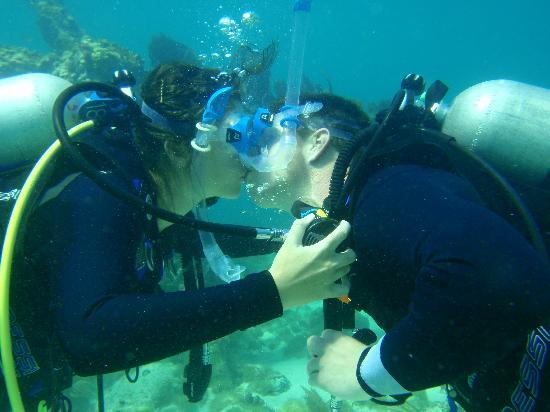 Captain Hook's Marina & Dive Center: This was NOT part of our training. Kiss for the birthday boy. :)