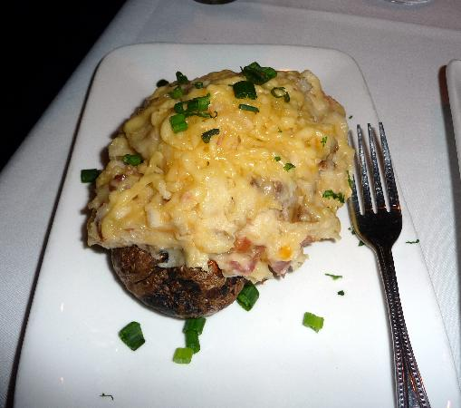 Fin's Grille and Raw Bar: Twice baked potatoe, shown with fork to see the enormous size