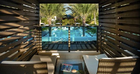Tideline Ocean Resort & Spa: RELAX IN ONE OF OUR POOLSIDE CABANAS
