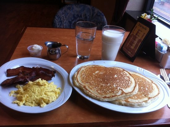 Gem Steakhouse & Saloon: the fluffiest giant pancakes with eggs and bacon...$9 with a glass of milk!