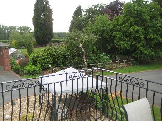 Longford, UK: View across garden from lounge
