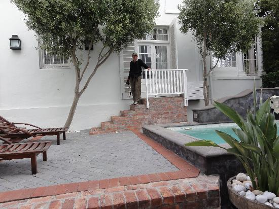 Cape Cadogan: Me at the door of our room from across the courtyard.