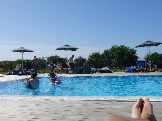 Martinhal Sagres Beach Resort & Hotel: Just finished breakfast and the pool is full of kids....who are not staying at the hotel??