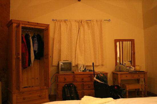 Sutton Lodge B&B: Wardrobe, TV, and dressing table (sorry about the mess)