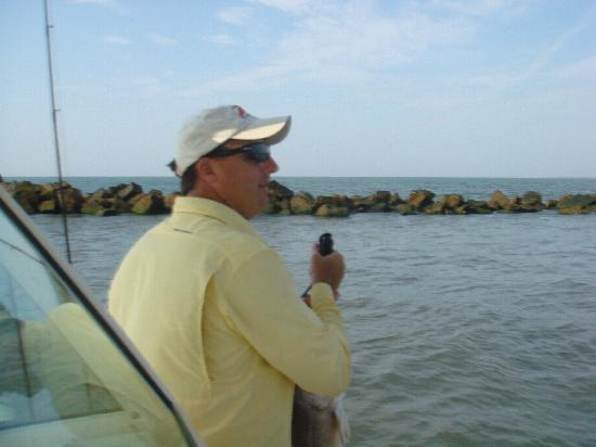 Reel Fish Finder Charters: Captain James helping us pull one in