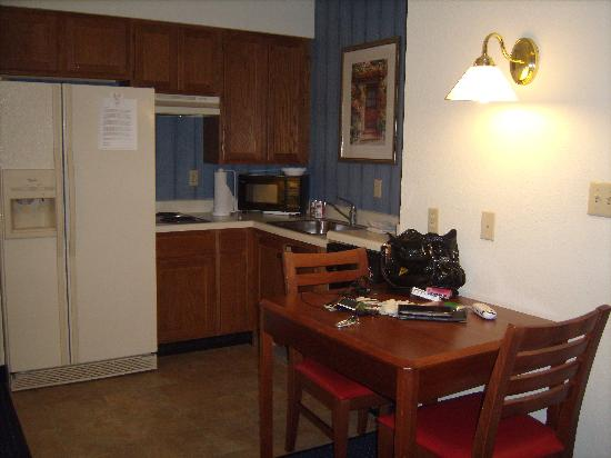 The Inn at Mayo Clinic: kitchen with plates, utensils, etc.