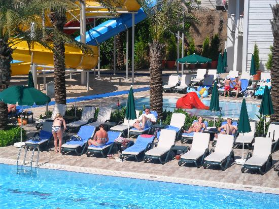 Alva Donna Beach Resort Comfort: Sunbeds near the water slide