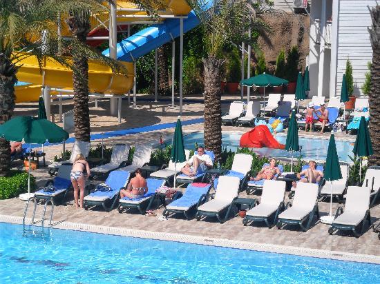 Alva Donna Beach Resort Comfort: Sunbeds near the water slide