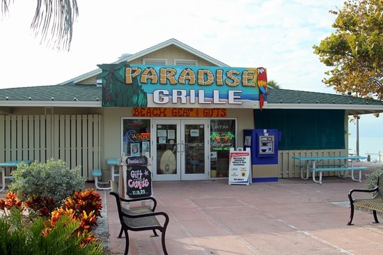 Paradise Grille: Front view from street. Eating area behind near Beach.