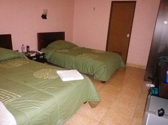 Pesona Beach Inn: new roomn, looking to bathroom door