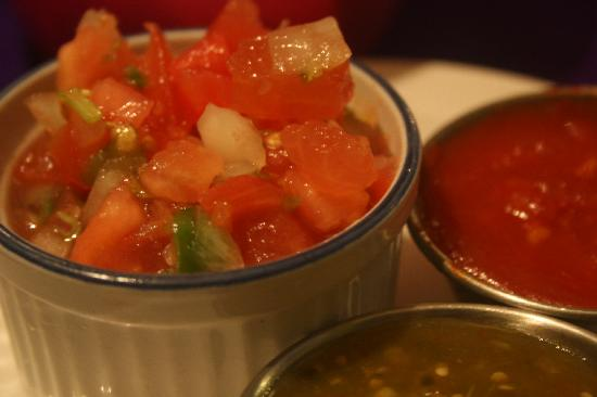 Cafe Guacamole Y Salsas : The fresh, delicious salsa and 2 hot sauces that came free to the table with homemade tortilla c