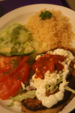 Cafe Guacamole Y Salsas: My husband had the Huarache de Chorizo. As good as it looks.