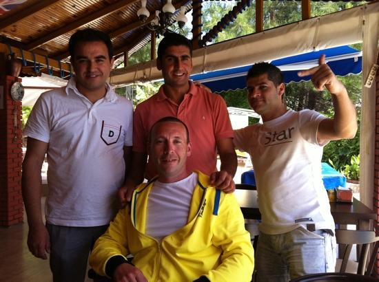 Celik Apart Hotel: my husband with some of the celik staff