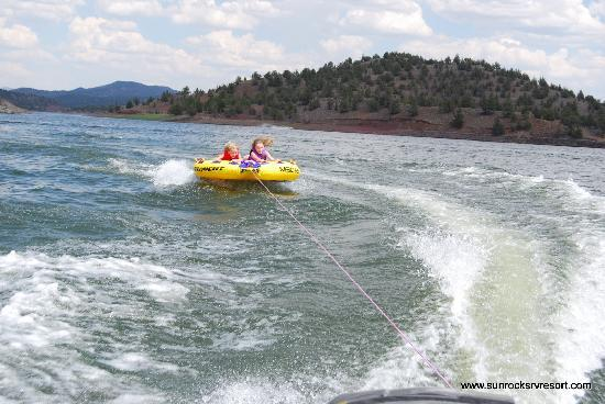 Sun Rocks RV Resort: the kids tubing behind the boat Prineville Reservoir