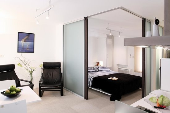 MirO Studio Apartments: The bedroom is separated from the living area with sliding glass doors