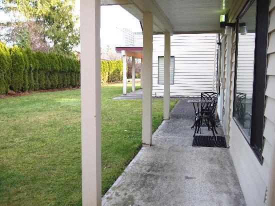 Whale's Tail Guest Suites: exterior looking at back yard from 1 bedroom