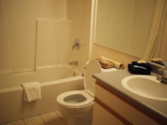 Whale's Tail Guest Suites: full washroom 1 in each unit with tub