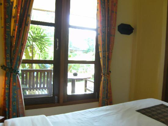 Palm Garden Resort Phuket: the main room is a bed, tv, nightstand, and closet
