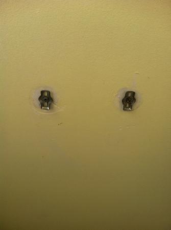 Knightsbridge Apartments: holes in bathroom wall where toilet roll should be