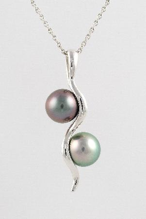 Eva Perles Pearl Buying: two pearls pendant