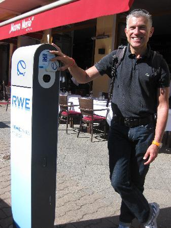 The Berlin Experts- Walking Tours: Jeremy explains the free pkg. spot/battery plug-ins to encourage 'green' auto usage!