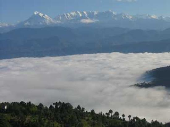 Kausani, India: snow capped mountains above the clouds