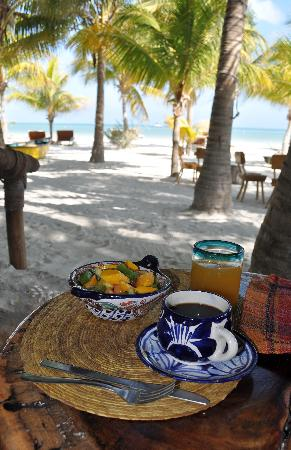 Holbox Hotel Mawimbi: Bowl of fruit, coffee, orange juice with your view of beach!