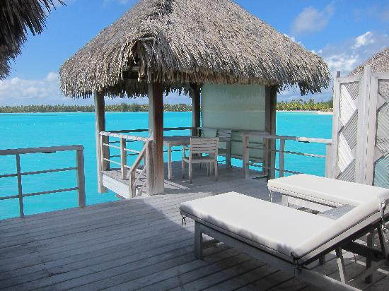 "The St. Regis Bora Bora Resort: Our porch (with the ""privacy"" screens shielding us from our neighbors on the right)"