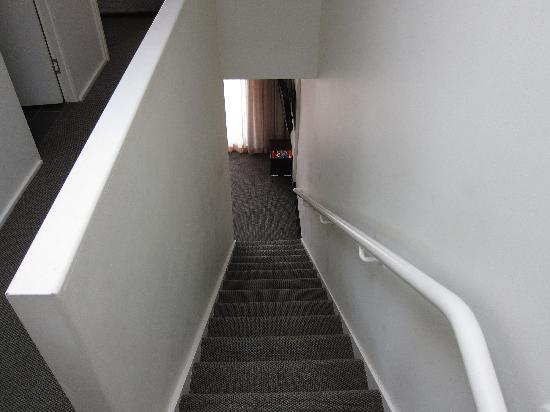 St Ives Apartments: stairs down to living hall and kitchen
