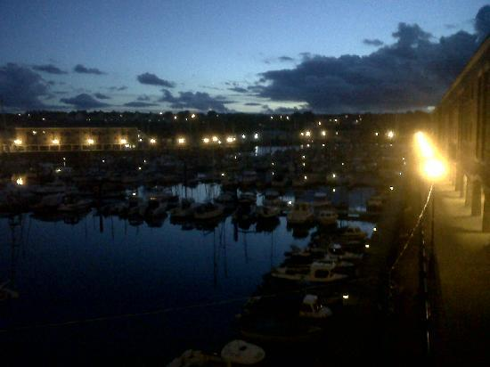 The Harbourmaster: Night time view from the balcony, looking towards the marina