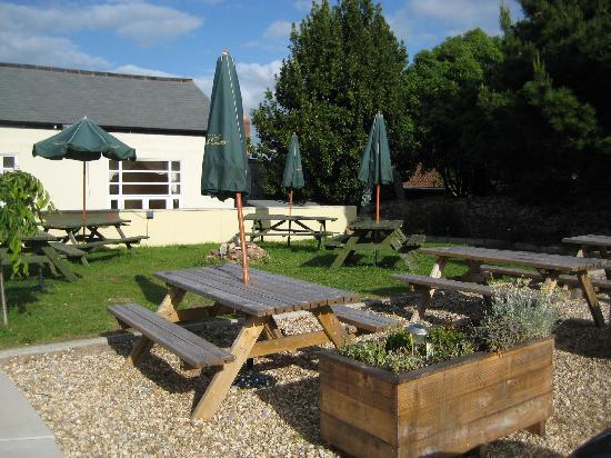 Dunster Castle Hotel: Beer garden by car park