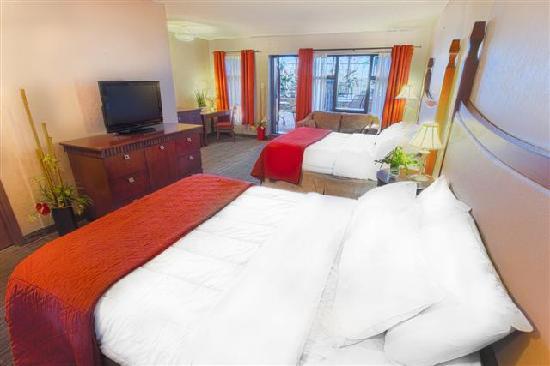 Hotel Universel Quebec: Chambre supérieure avec 2 lits Queens et un balcon sur le jardin intérieur