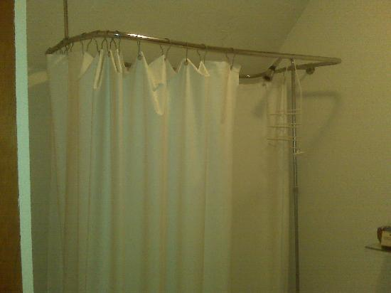 The Rogers House : Shower curtain to bathtub.