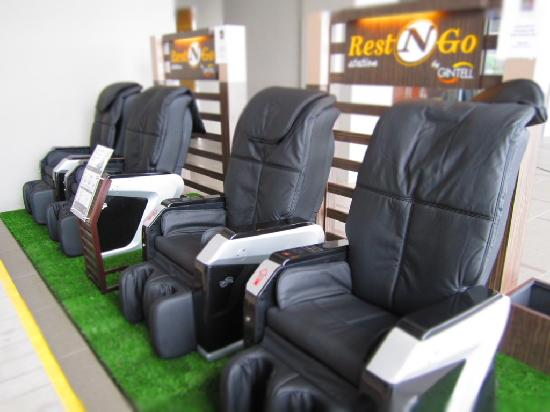 Payable Massage chairs near the pool - Picture of V Hotel
