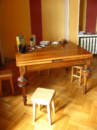 Why Not? Tbilisi Legend Hostel: Breakfast table - love the carved legs!