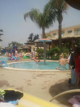 Baby pool picture of tasia maris gardens apartments for Baby garden pool
