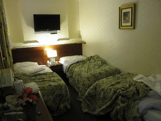 Falcon Hotel: I just can't believe there are three beds in that room!